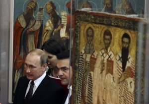 Greek Prime Minister Alexis Tsipras, right, and Russian President Vladimir Putin visit the Byzantine and Christian museum in Athens, Friday, May 27, 2016. Russian President Vladimir Putin has traveled to Greece to visit a secluded Christian Orthodox monastic sanctuary and discuss energy and privatization deals in the cash-strapped country. (AP Photo/Thanassis Stavrakis, Pool)